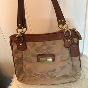 Coach Shoulder Bag cloth with leather detailing.